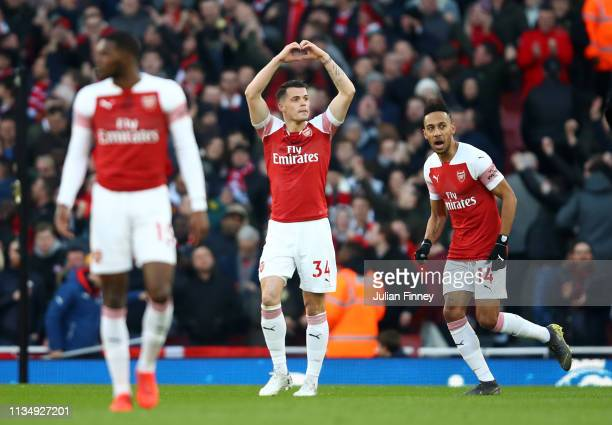 Granit Xhaka of Arsenal celebrates after scoring his team's first goal during the Premier League match between Arsenal FC and Manchester United at...