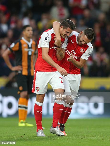 Granit Xhaka of Arsenal celebrates scoring his sides first goal with his team mate Lucas Perez of Arsenal during the Premier League match between...