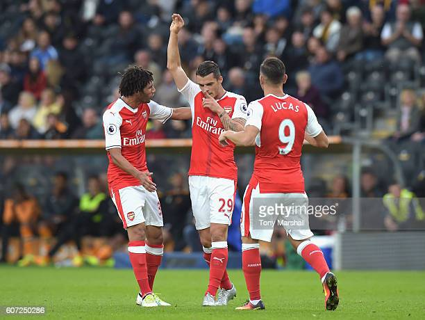 Granit Xhaka of Arsenal celebrates scoring his sides first goal with team mates during the Premier League match between Hull City and Arsenal at KCOM...