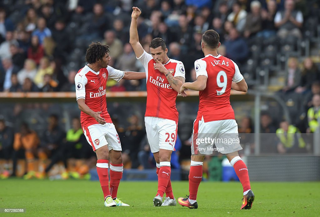 Granit Xhaka of Arsenal celebrates scoring his sides first goal with team mates during the Premier League match between Hull City and Arsenal at KCOM Stadium on September 17, 2016 in Hull, England.