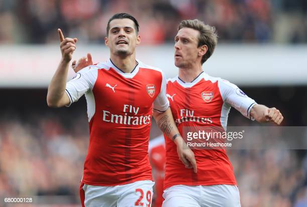 Granit Xhaka of Arsenal celebrates scoring his sides first goal with Nacho Monreal of Arsenal during the Premier League match between Arsenal and...