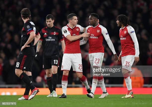 Granit Xhaka of Arsenal celebrates scoring the second goal with Danny Welbeck during the UEFA Europa League Round of 16 Second Leg match between...