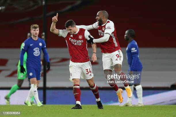 Granit Xhaka of Arsenal celebrates scoring their 2nd goal with Alexandre Lacazette who scored their 1st during the Premier League match between...