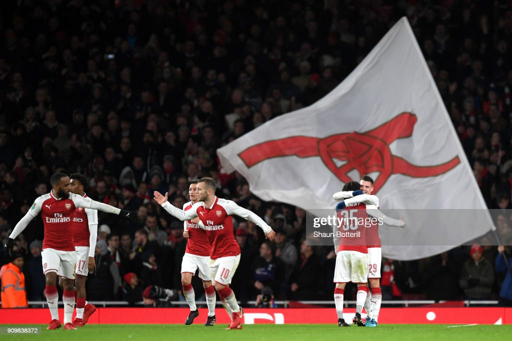 Granit Xhaka of Arsenal celebrates with team mates after scoring his sides second goal during the Carabao Cup Semi-Final Second Leg at Emirates Stadium on January 24, 2018 in London, England.