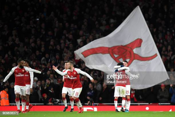 Granit Xhaka of Arsenal celebrates with team mates after scoring his sides second goal during the Carabao Cup SemiFinal Second Leg at Emirates...