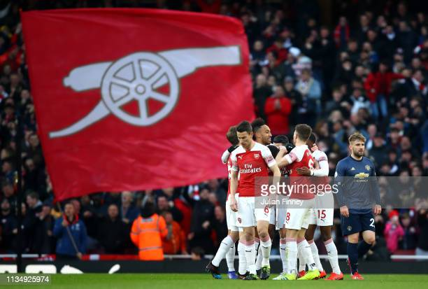 Granit Xhaka of Arsenal celebrates with teammates after scoring his team's first goal during the Premier League match between Arsenal FC and...