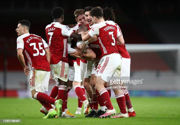 Granit Xhaka of Arsenal celebrates with teammates Gabriel Martinelli, Bukayo Saka, Alexandre Lacazette, Emile Smith Rowe, Hector Bellerin, Mohamed...