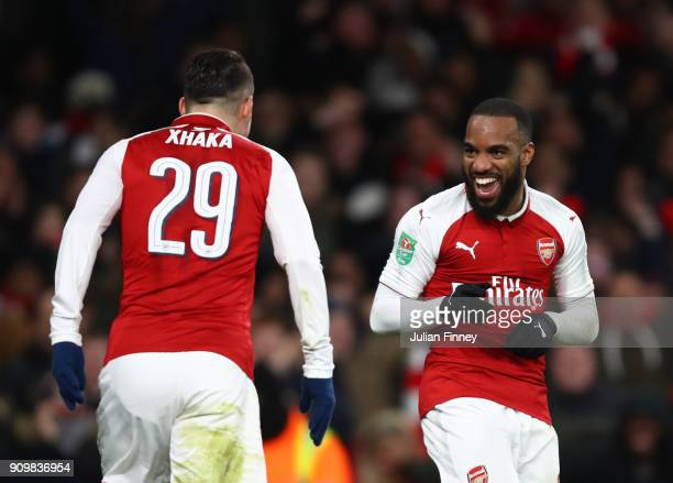 Granit Xhaka of Arsenal celebtrates scoring his sides second goal with the 1st goalscorer Alexandre Lacazette during the Carabao Cup SemiFinal Second...