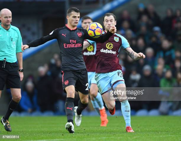 Granit Xhaka of Arsenal challenged by Ashley Barnes of Burnley during the Premier League match between Burnley and Arsenal at Turf Moor on November...