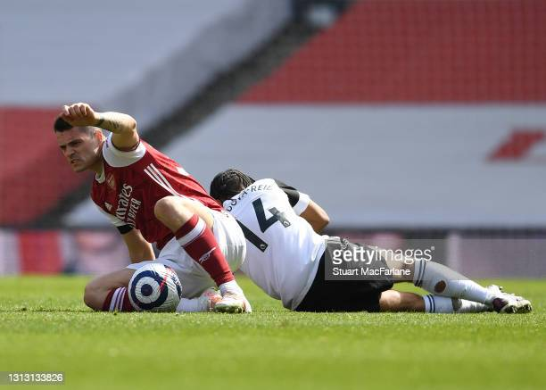 Granit Xhaka of Arsenal challenged by Bobby De Cordova-Reid of Fulham during the Premier League match between Arsenal and Fulham at Emirates Stadium...