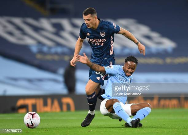 Granit Xhaka of Arsenal challenged by Raheem Sterling of Man City during the Premier League match between Manchester City and Arsenal at Etihad...