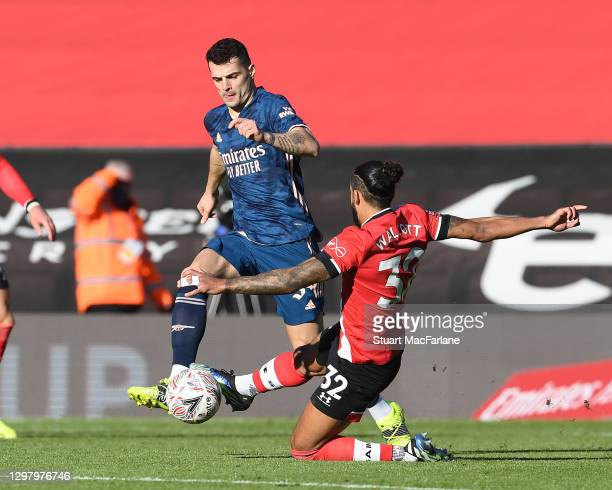 Granit Xhaka of Arsenal challenged by Theo Walcott of Southampton during on January 23, 2021 in Southampton, England. Sporting stadiums around the UK...