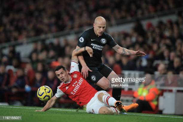 Granit Xhaka of Arsenal challenges Aaron Mooy of Brighton during the Premier League match between Arsenal FC and Brighton Hove Albion at Emirates...