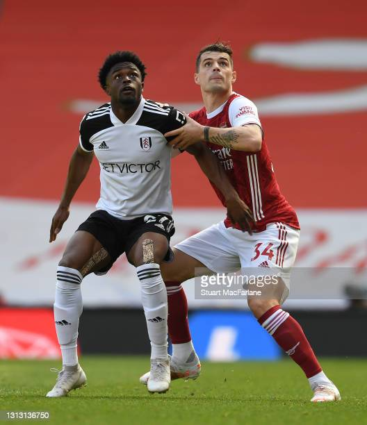Granit Xhaka of Arsenal challenges Josh Maja of Fulham during the Premier League match between Arsenal and Fulham at Emirates Stadium on April 18,...