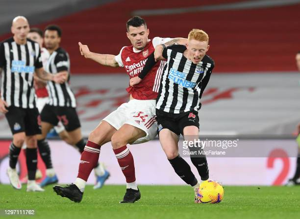 Granit Xhaka of Arsenal challenges Matthew Longstaff of Newcastle United during the Premier League match between Arsenal and Newcastle United at...