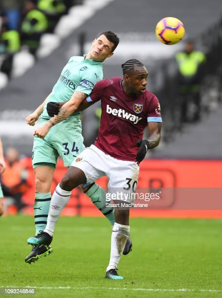 Granit Xhaka of Arsenal challenges Michail Antonio of West Ham during the Premier League match between West Ham United and Arsenal FC at London...