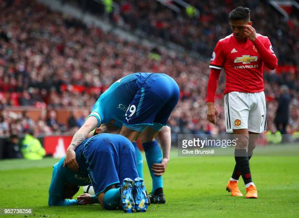 Granit Xhaka of Arsenal checks on Henrikh Mkhitaryan of Arsenal as he goes down in pain during the Premier League match between Manchester United and...