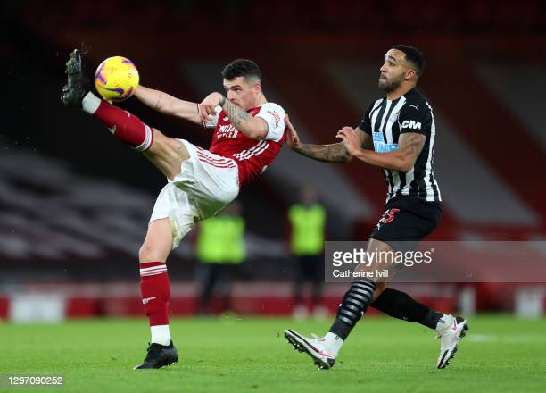 Granit Xhaka of Arsenal controls the ball under pressure from Callum Wilson of Newcastle United during the Premier League match between Arsenal and...
