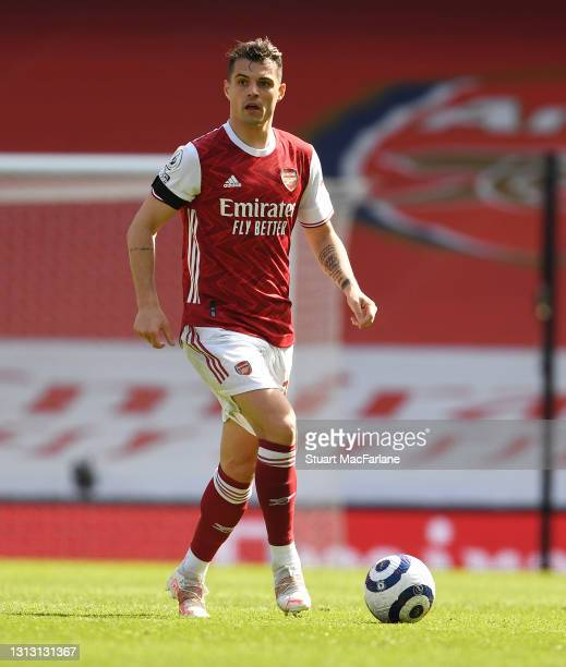 Granit Xhaka of Arsenal during the Premier League match between Arsenal and Fulham at Emirates Stadium on April 18, 2021 in London, England. Sporting...