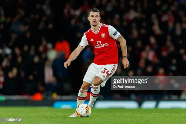 Granit Xhaka of Arsenal FC controls the ball during the UEFA Europa League round of 32 second leg match between Arsenal FC and Olympiacos FC at...