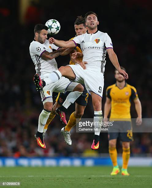 Granit Xhaka of Arsenal gets caught between Renato Steffen and Andraz Sporar of FC Basel during the UEFA Champions League match between Arsenal FC...