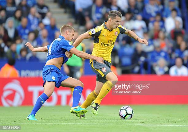 Granit Xhaka of Arsenal holds off Mark Albrighton of Leicester during the Premier League match between Leicester City and Arsenal at The King Power...