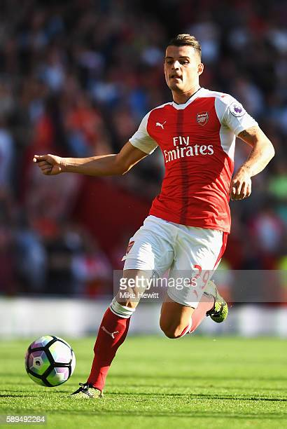 Granit Xhaka of Arsenal in action during the Premier League match between Arsenal and Liverpool at Emirates Stadium on August 14 2016 in London...