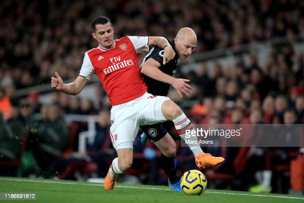 Granit Xhaka of Arsenal in action with Aaron Mooy of Brighton and Hove Albion during the Premier League match between Arsenal FC and Brighton Hove...