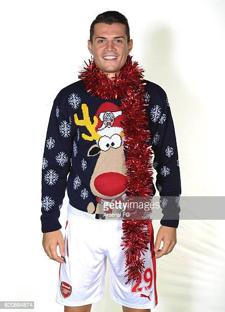 Granit Xhaka of Arsenal in his Arsenal Christmas Jumper to support Save the Children Christmas Jumper Day at London Colney on October 21 2016 in St...