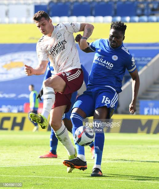 Granit Xhaka of Arsenal is challenged by Daniel Amartey of Leicester during the Premier League match between Leicester City and Arsenal at The King...