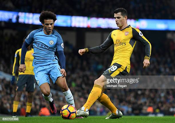 Granit Xhaka of Arsenal is put under pressure from Leroy Sane of Manchester City during the Premier League match between Manchester City and Arsenal...