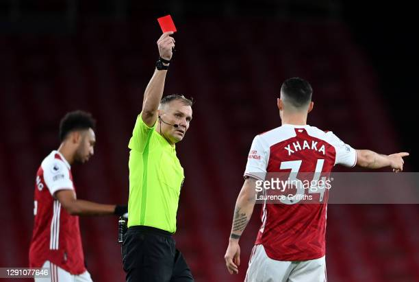 Granit Xhaka of Arsenal is shown a red card by match referee Graham Scott during the Premier League match between Arsenal and Burnley at Emirates...