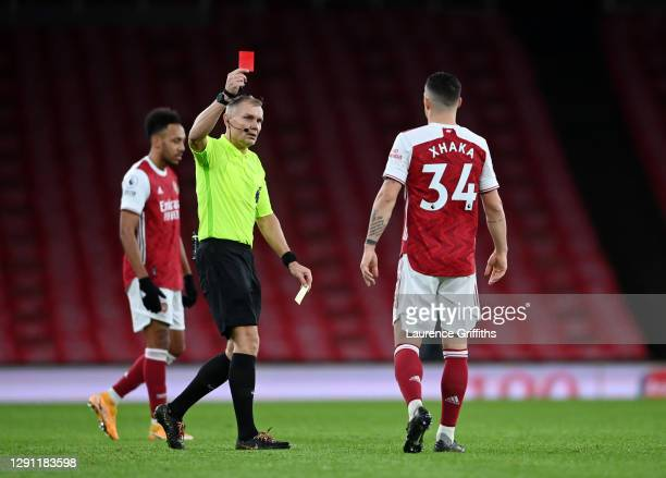 Granit Xhaka of Arsenal is shown a Red Card by Referee, Graham Scott during the Premier League match between Arsenal and Burnley at Emirates Stadium...