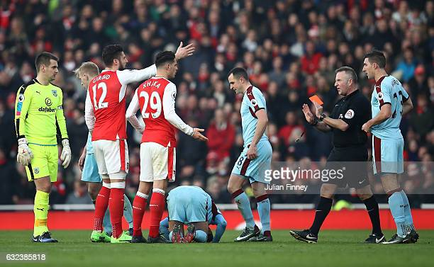 Granit Xhaka of Arsenal is shown a red card by referee Jonathan Moss during the Premier League match between Arsenal and Burnley at the Emirates...