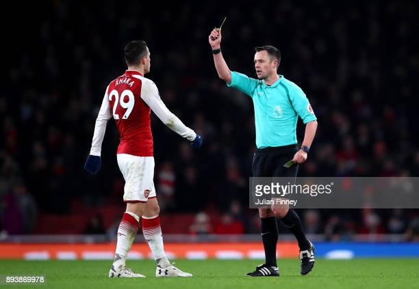 Granit Xhaka of Arsenal is shown a yellow card by referee Stuart Attwell during the Premier League match between Arsenal and Newcastle United at...