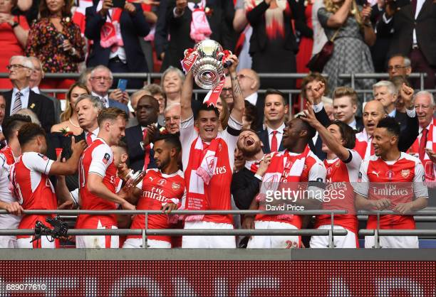 Granit Xhaka of Arsenal lifts the FA Cup Trophy after the match between Arsenal and Chelsea at Wembley Stadium on May 27 2017 in London England