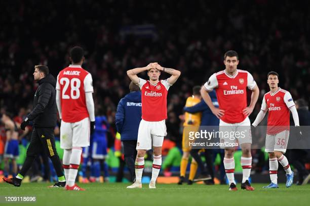 Granit Xhaka of Arsenal looks dejected following his team's defeat in the UEFA Europa League round of 32 second leg match between Arsenal FC and...