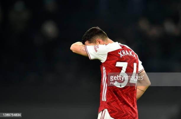 Granit Xhaka of Arsenal looks dejected following the Premier League match between Tottenham Hotspur and Arsenal at Tottenham Hotspur Stadium on...