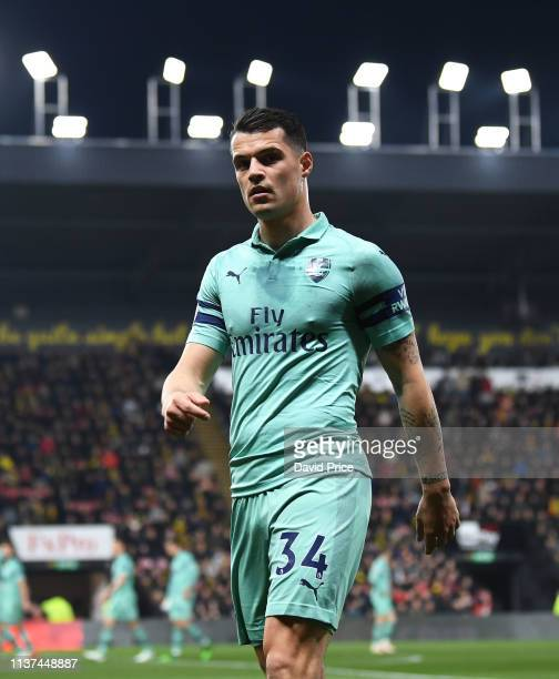 Granit Xhaka of Arsenal looks on during the Premier League match between Watford FC and Arsenal FC at Vicarage Road on April 15 2019 in Watford...
