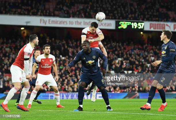 Granit Xhaka of Arsenal outjumps Romelu Lukaku of Manchester United during the FA Cup Fourth Round match between Arsenal and Manchester United at...