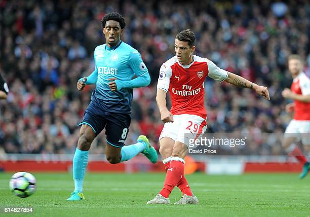 Granit Xhaka of Arsenal passes under pressure from Leroy Fer of Swansea during the Premier League match between Arsenal and Swansea City at Emirates...