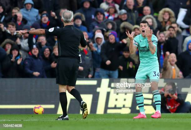 Granit Xhaka of Arsenal reacts as Referee Martin Atkinson awards Crystal Palace a penalty during the Premier League match between Crystal Palace and...
