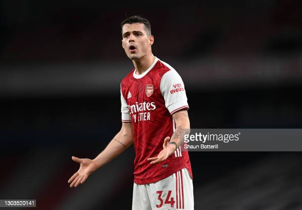 Granit Xhaka of Arsenal reacts during the Premier League match between Arsenal and Manchester City at Emirates Stadium on February 21, 2021 in...
