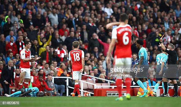 Granit Xhaka of Arsenal reacts to being shown a red card by referee Jonanthan Moss during the Premier League match between Arsenal and Swansea City...