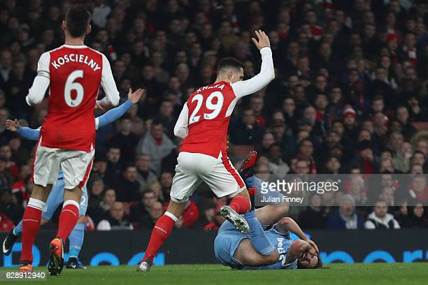 Granit Xhaka of Arsenal reacts to Joe Allen of Stoke City going down after being challenged by Shkodran Mustafi of Arsenal during the Premier League...