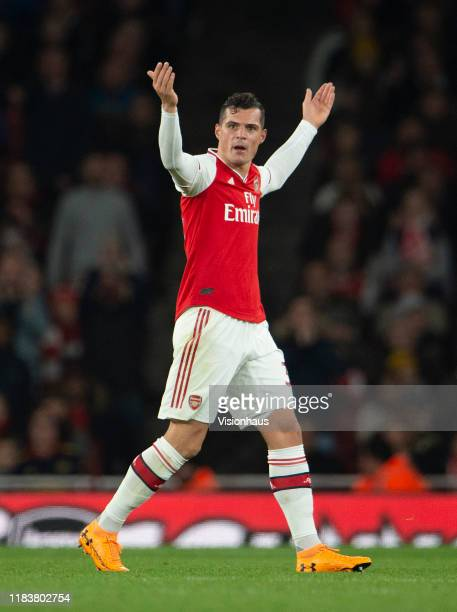 Granit Xhaka of Arsenal reacts to the crowd after being substituted by Manager Unai Emery during the Premier League match between Arsenal FC and...