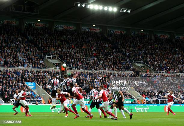 Granit Xhaka of Arsenal scores his side's first goal during the Premier League match between Newcastle United and Arsenal FC at St James Park on...