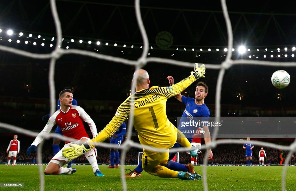 Granit Xhaka of Arsenal scores his sides second goal past Willy Caballero of Chelsea during the Carabao Cup Semi-Final Second Leg at Emirates Stadium on January 24, 2018 in London, England.