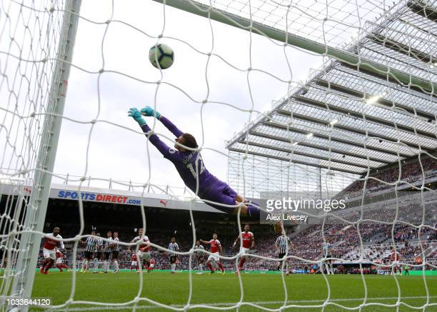 Granit Xhaka of Arsenal scores his team's first goal past Martin Dubravka of Newcastle United during the Premier League match between Newcastle...