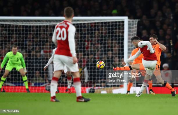 Granit Xhaka of Arsenal scores his teams second goal during the Premier League match between Arsenal and Liverpool at Emirates Stadium on December 22...